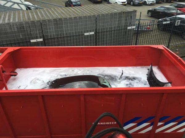 BMW in vat of water