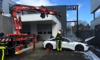 Firefighters Dunk Smoking BMW Hybrid Electric Vehicle in Huge Vat to Put It Out