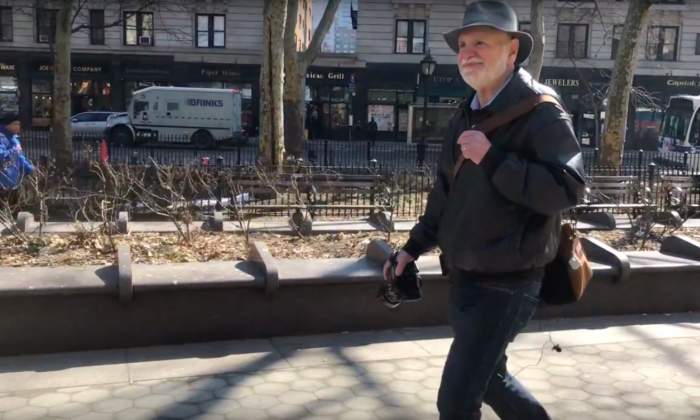 Photographer Herb Bardavid walking on the street of the Upper West Side, New York City on March 9, 2019 (Penny Zhou/The Epoch Times)