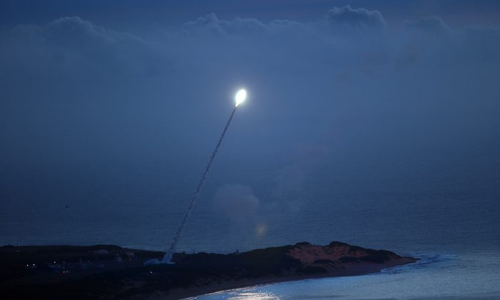 A missile is launched from the Pacific Missile Range Facility (PMRF) to be intercepted as part of a Missile Defense Agency test in Kaui, Hawaii, on Nov. 6, 2007. (US Navy via Getty Images)
