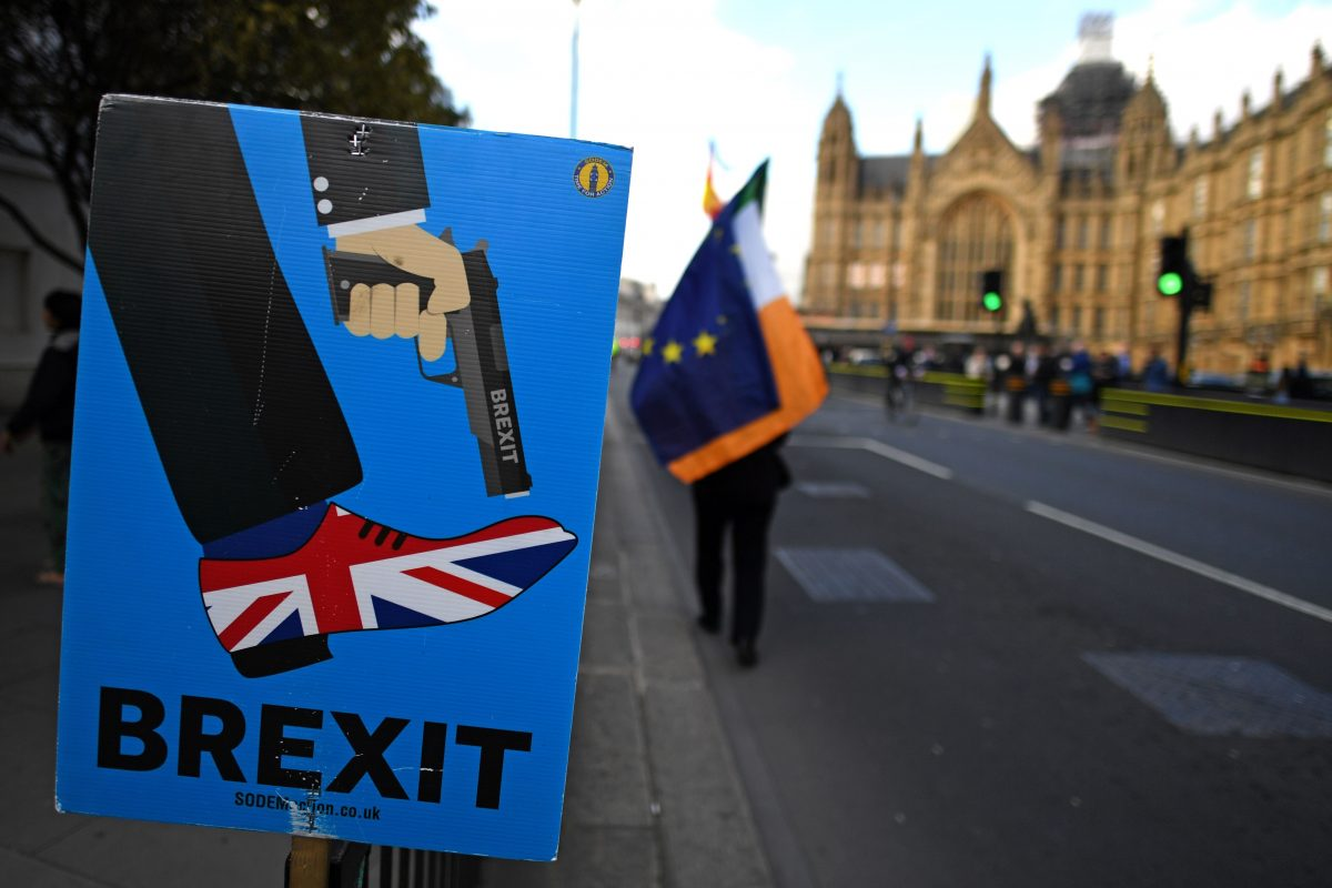 An anti-Brexit activist demonstrates near the Houses of Parliament