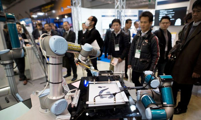 Universal Robots A/S robotic arms are demonstrated at the Robodex (Robot Development & Application Expo) trade show in Tokyo, on Jan. 18, 2017 in Tokyo, Japan. (Tomohiro Ohsumi/Getty Images)