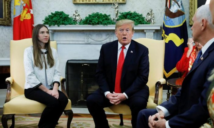 President Donald Trump and Vice President Mike Pence meet with Fabiana Rosales, wife of Venezuelan opposition leader Juan Guaidó, in the Oval Office at the White House in Washington, on March 27, 2019. (Carlos Barria/Reuters)
