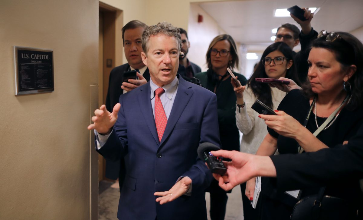 Sen. Rand Paul talks to reporters as he heads to the U.S. Capitol for the weekly Republican policy luncheon