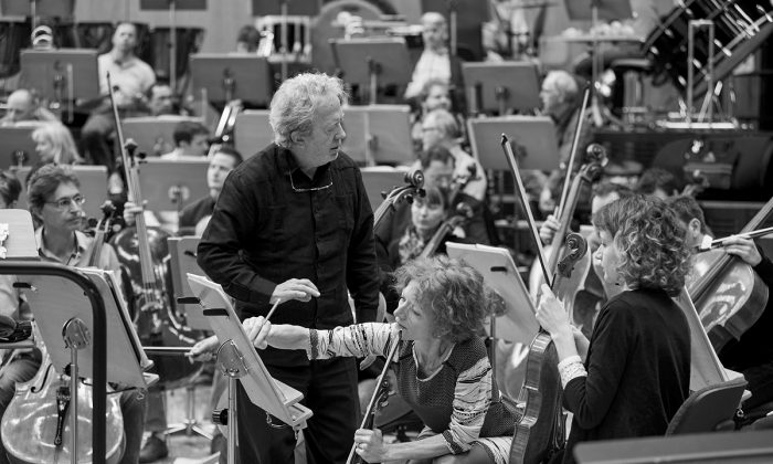 "John Nelson with the Strasbourg Philharmonic orchestra, preparing ""Les Troyens.""(Gregory Massat)"