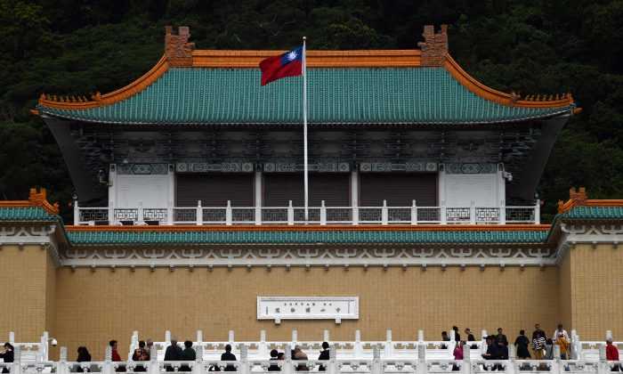 Tourists walk in front of Taiwan's National Palace Museum in Taipei on March 13, 2019. (Sam Yeh/AFP)