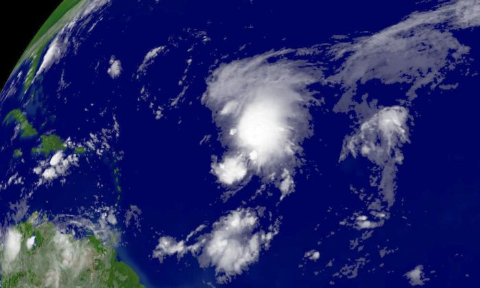 In this satellite image provided by the National Oceanic and Atmospheric Administration, Tropical Storm Florence is shown located northeast of Bardados on Sept. 6, 2006. In a letter, John Kerry argued that Hurricane Florence was an example of global warming damaging national security. (NOAA via Getty Images)