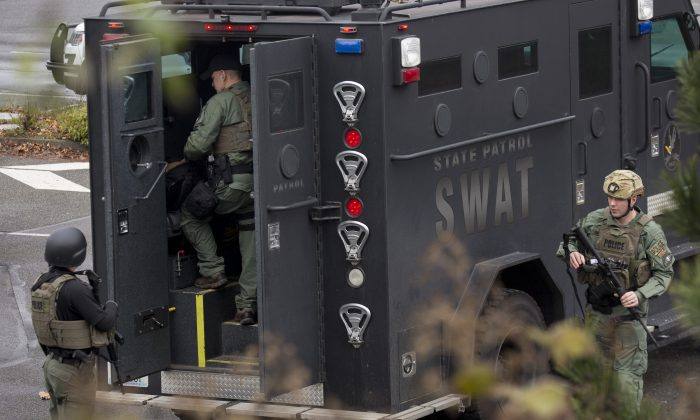 In this file photo, members of a SWAT team work in a parking lot in Des Moines, Wash., on Feb. 16, 2018. (David Ryder/Getty Images)