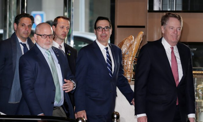Members of the U.S. trade delegation Robert Lighthizer and Steven Mnuchin arrive at a hotel in Beijing on March 28, 2019. (Jason Lee/Reuters)