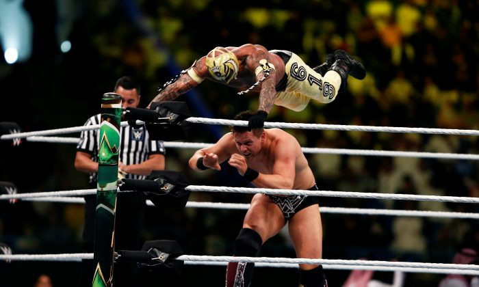 """FILE PHOTO: Rey Mysterio is seen in action against The Miz during the quarter-final match of WWE """"Crown Jewel"""" World Cup 2018 tournament at King Saud University stadium in Riyadh, November 2, 2018. REUTERS/Faisal al Nasser"""