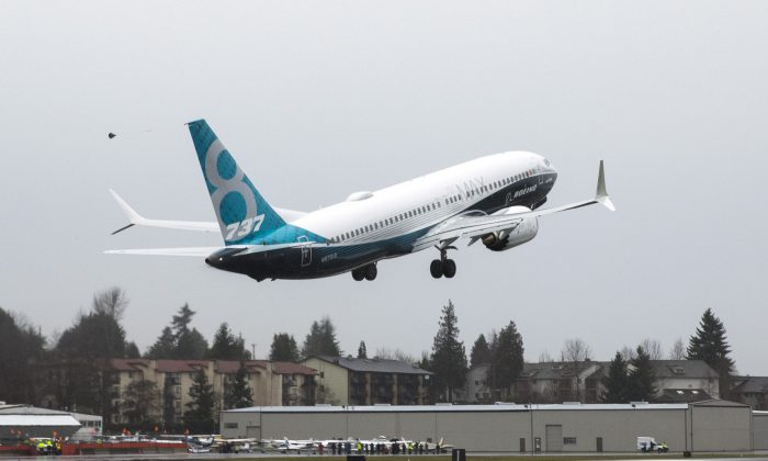 A Boeing 737 MAX 8 takes off during a flight test in Renton, Wash., on Jan. 29, 2016. (Jason Redmond/File Photo via Reuters)