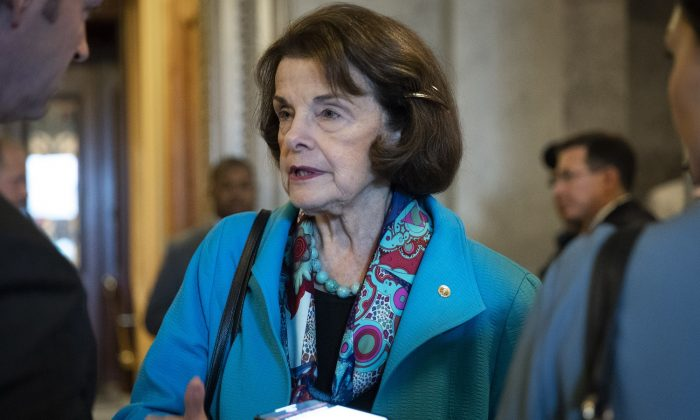 Sen. Dianne Feinstein (D-Calif.) as she exits the Senate floor in Washington on Oct. 6, 2018. For 20 years Feinstein had a Chinese spy on her staff, a matter that has never been adequately investigated. (Drew Angerer/Getty Images)