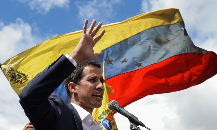 Venezuela's National Assembly head Juan Guaido speaks to the crowd during a mass opposition rally against leader Nicolas Maduro in which he declared himself the country's acting president, on the anniversary of a 1958 uprising that overthrew a military dictatorship, in Caracas on Jan. 23, 2019. (Federico Parra/AFP)