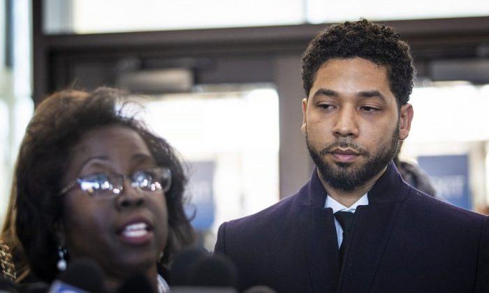 Actor Jussie Smollett, right, listens as his attorney, Patricia Brown Holmes, speaks to reporters at the Leighton Criminal Courthouse after prosecutors dropped all charges against him on March 26, 2019. (Ashlee Rezin/Sun-Times/Chicago Sun-Times via AP)