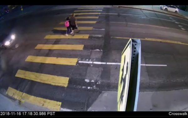 man and daughter on crosswalk