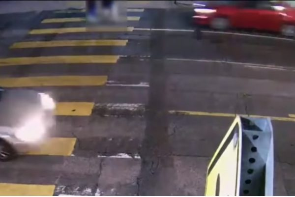 car speeding towards pedestrians