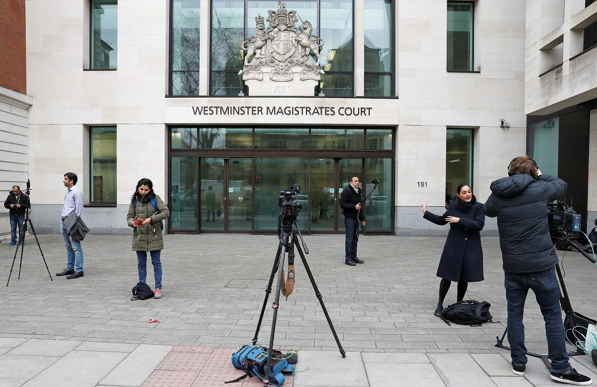 Indian journalists are seen outside the Westminster Magistrates court in London