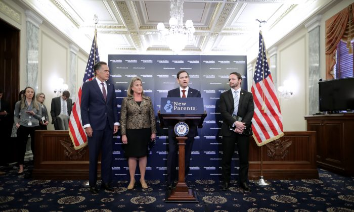 (L-R) Sen. Mitt Romney (R-Utah), Rep. Ann Wagner (R-Mo.), Sen. Marco Rubio (R-Fla.) and Rep. Dan Crenshaw (R-Texas) introduce their paid family leave legislation during a news conference in the Russell Senate Office Building on Capitol Hill in Washington on March 27, 2019. (Chip Somodevilla/Getty Images)