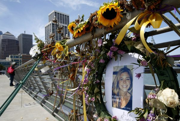 flowers and a portrait of Kate Steinle