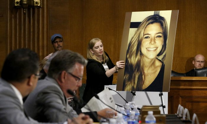 A photo of murder victim Kate Steinle is placed on an easel as her father Jim Steinle (2nd L) prepares to testify about her murder during a hearing of the Senate Judiciary Committee on immigration enforcement policies, on Capitol Hill in Washington, on July 21, 2015. (Jonathan Ernst/Reuters)