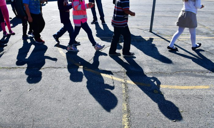 Children's shadows at an elementary school outside of L.A., in Calif., on Feb. 8, 2019. (Frederic J. Brown/AFP/Getty Images)