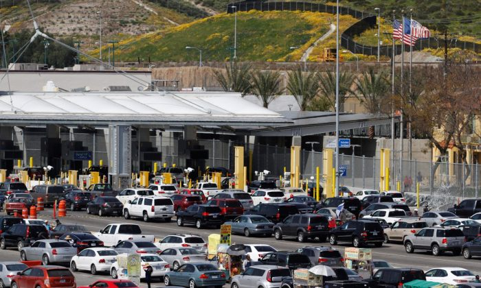 Cars queue up in multiple lines as they wait to be inspected by U.S. border patrol officers to enter from Mexico into the U.S., at the San Ysidro point of entry, in Tijuana, Mexico, on March 29, 2019. (Jorge Duenes/Reuters)