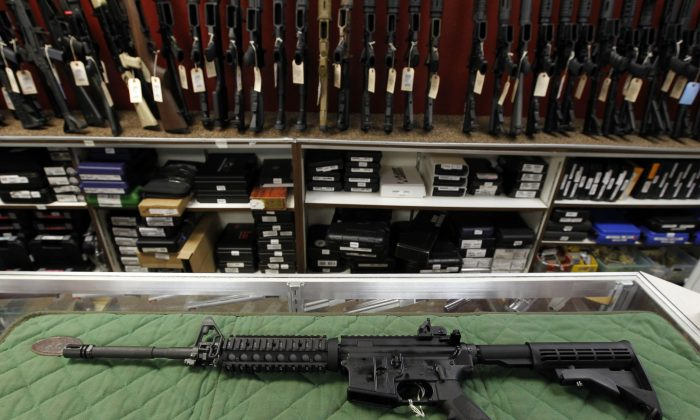 An AR-15 style rifle is displayed at the Firing-Line indoor range and gun shop, in Aurora, Colo., on July 26, 2012. (Alex Brandon/AP Photo)