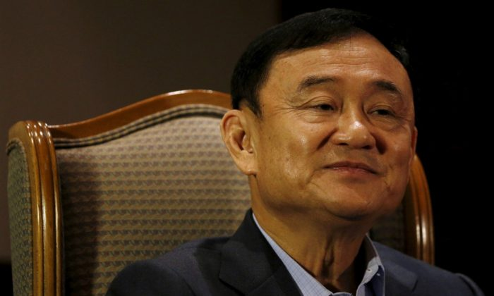 Former Thai Prime Minister Thaksin Shinawatra looks on as he speaks to Reuters during an interview in Singapore, on Feb. 23, 2016. (Edgar Su/Reuters)