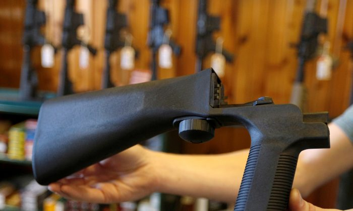 A bump fire stock that attaches to a semi-automatic rifle to increase the firing rate is seen at Good Guys Gun Shop in Orem, Utah, Oct. 4, 2017. REUTERS/George Frey/File Photo