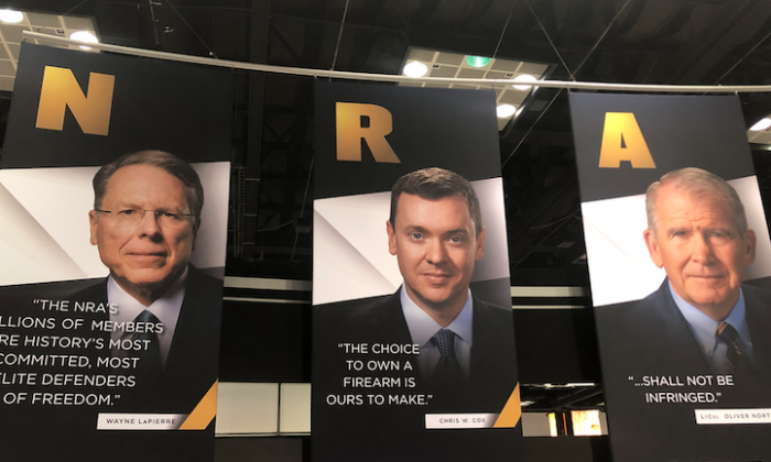 A poster at the NRA annual event at the Indianapolis Convention Center in Indianpolis, Indiana on April 28, 2019. (Nathan Su/The Epoch Times)