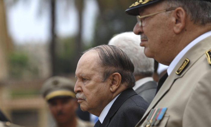Algerian President Abdelaziz Bouteflika, left, and his Army chief of staff, Gen. Ahmed Gaid Salah, review an honor guard before attending a military parade, in Cherchell near Algiers, Algeria on June 27, 2012.  (Anis Belghoul/AP Photo)