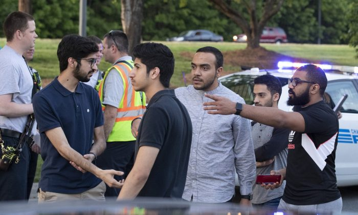 People gather across from the campus of University of North Carolina at Charlotte after a shooting at the school in Charlotte, N.C., on April 30, 2019. (Jason E. Miczek/AP Photo)
