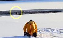 Video: Firefighter Crawls Across Frozen Lake to Rescue Terrified Dog Trapped in Icy Lake