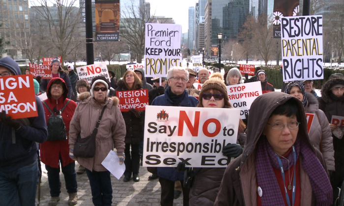 People gather to call on Premier Doug Ford to keep his promise to repeal the controversial 2015 sex education curriculum at Queen's Park in Toronto on Feb. 2, 2019. (NTD Television)