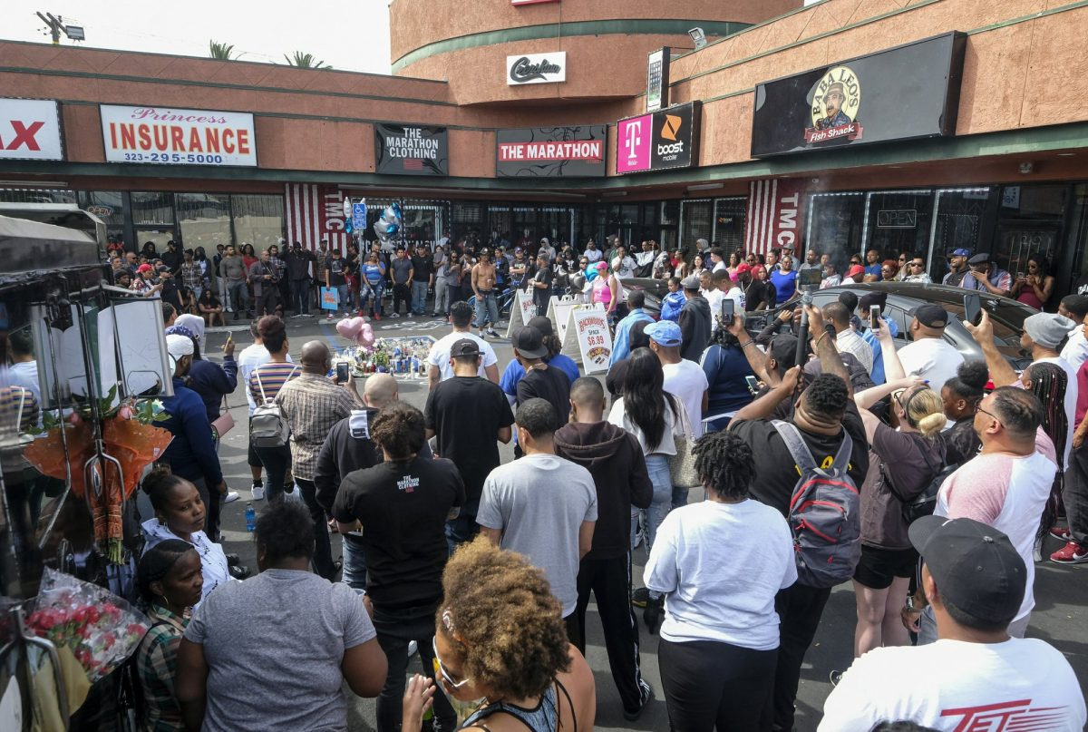 Fans of rapper Nipsey Hussle gather at a makeshift memorial