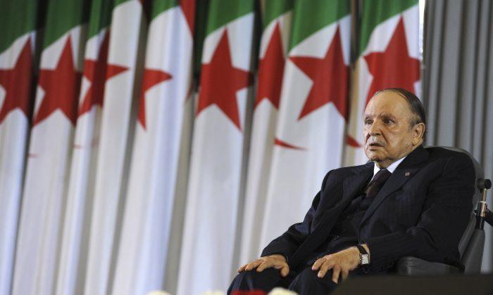 Algerian President Abdelaziz Bouteflika sits on a wheelchair after taking oath as President, in Algiers, Algeria, on April 28, 2014. (Sidali Djarboub/AP Photo)