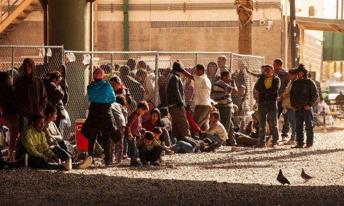 Migrants awaiting processing are held in temporary fencing underneath the Paso Del Norte Bridge  on March 28, 2019 in El Paso, Texas. U.S. Christ Chavez/Getty Images