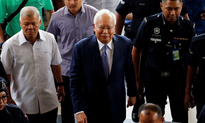 Former Malaysia's Prime Minister Najib Razak arrives at Kuala Lumpur High Court in Kuala Lumpur, Malaysia April 3, 2019. REUTERS/Lai Seng Sin