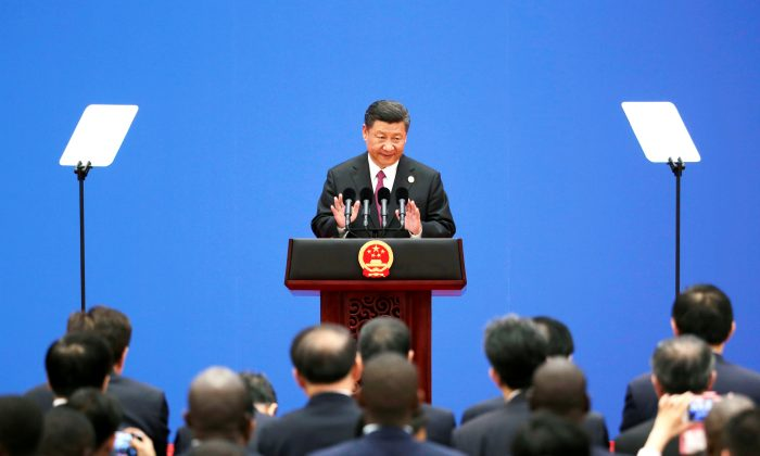 "Chinese leader Xi Jinping attends a news conference at the end of the ""One Belt, One Road"" Forum in Beijing on May 15, 2017. (Jason Lee/Reuters)"