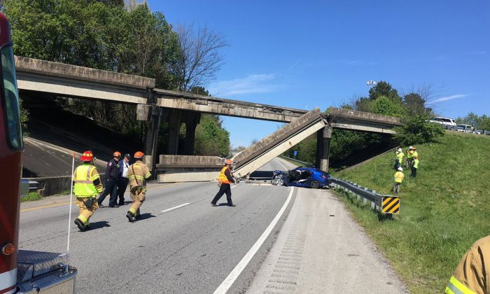 A concrete railing fell from a bridge onto the roadway below in Chattanooga, Tenn., April 1, 2019. (Chattanooga Fire Department via CNN)