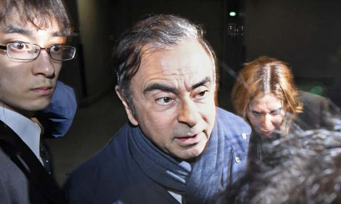 Former Nissan Motor Chairman Carlos Ghosn leaves his lawyer's office in Tokyo, Japan on April 3, 2019. (Kyodo/via REUTERS)