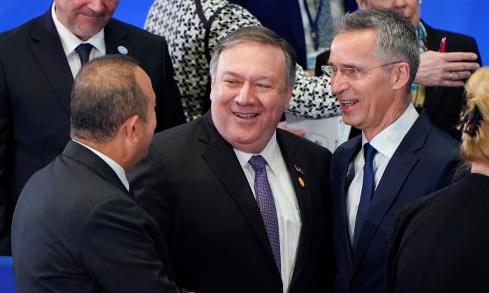 Turkish Foreign Minister Mevlut Cavusoglu greets U.S. Secretary of State Mike Pompeo and NATO Secretary General Jens Stoltenberg at a meeting of the North Atlantic Treaty Organization (NATO) Foreign Ministers at the State Department in Washington, U.S., April 4, 2019.      REUTERS/Joshua Roberts
