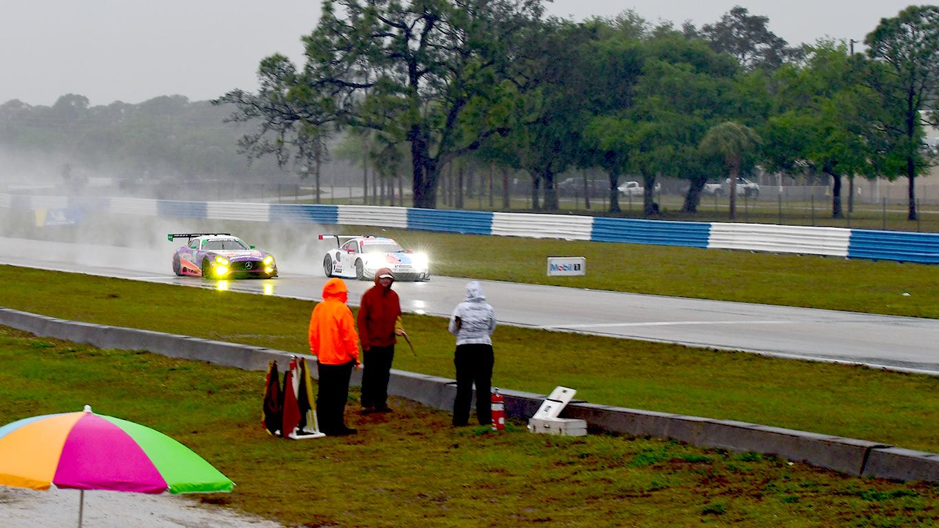 Corner workers endure the rain.