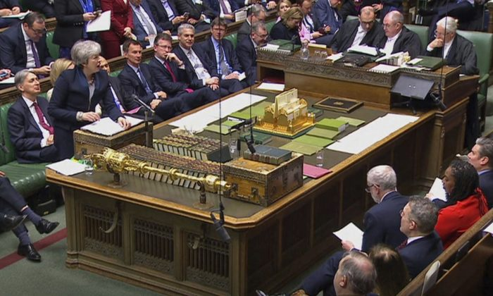 In this grab taken from video, Britain's Prime Minister Theresa May speaks during Prime Minister's Questions in the House of Commons, London, Wednesday April 3, 2019. With Britain racing toward a chaotic exit from the European Union within days, May veered away from the cliff-edge Tuesday, saying she would seek another Brexit delay and hold talks with the opposition to seek a compromise. (House of Commons/PA via AP)