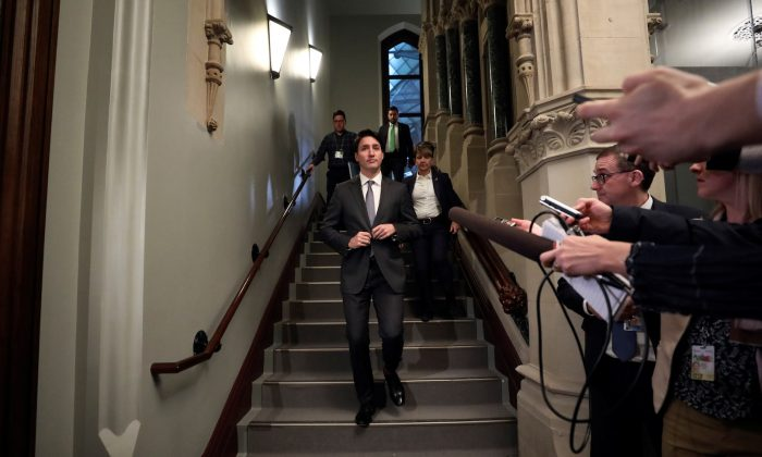 Canada's Prime Minister Justin Trudeau arrives for a Liberal Party caucus meeting on Parliament Hill in Ottawa, Ontario, Canada, on April 2, 2019. (Chris Wattie/Reuters)