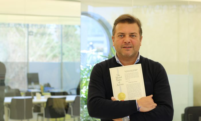 Portuguese entrepreneur Rui Pedro Oliveira holding the patent certificate for his smartphone attachable camera. (Supplied)