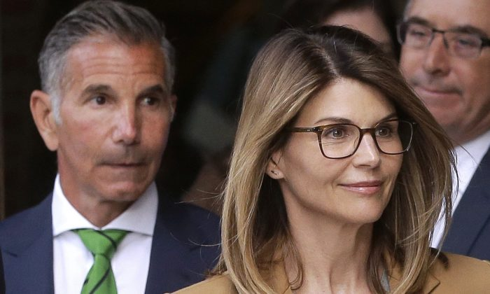 Actress Lori Loughlin (front) and husband, clothing designer Mossimo Giannulli depart federal court in Boston on April 3, 2019. (Steven Senne/AP Photo)