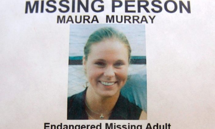 A missing person poster of Maura Murray in the lobby of the police station in Haverhill, New Hampshire, on Feb. 4, 2014. (AP Photo/Jim Cole)