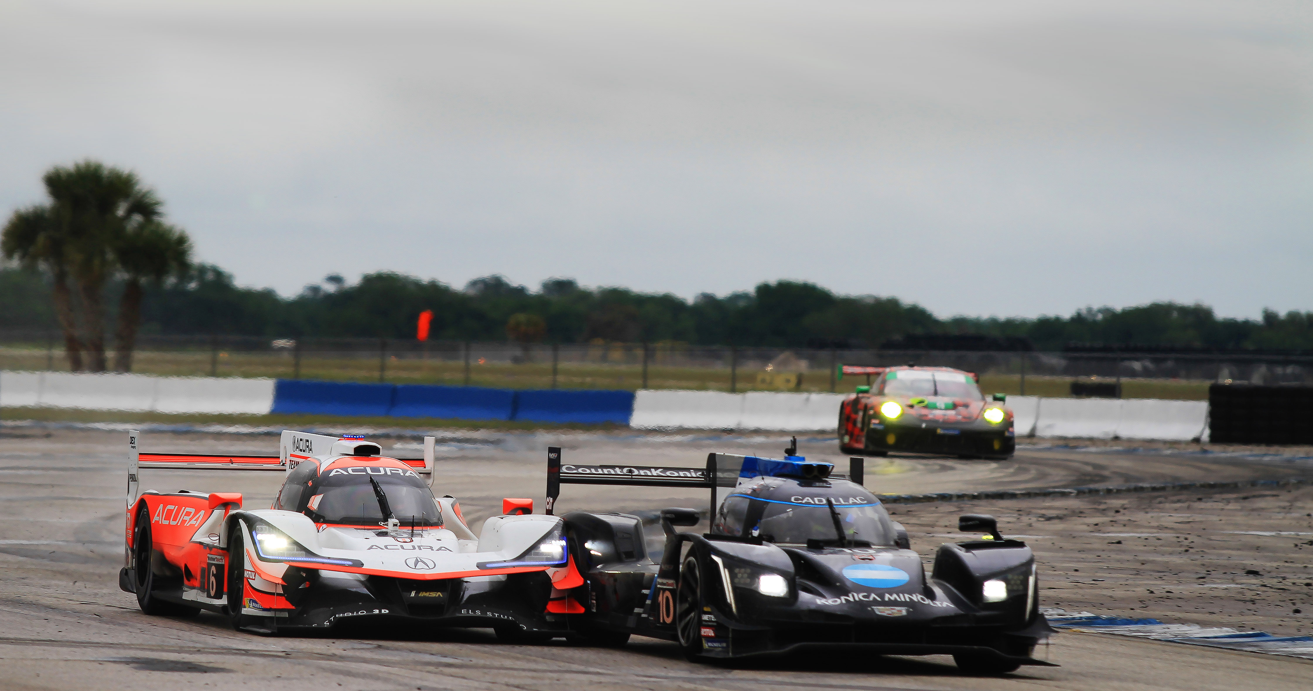 The #6 Acura and #10 WTR Cadillac battle for position