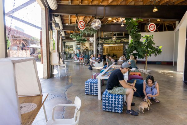 Shoppers relax on cushions and swinging benches at the lab